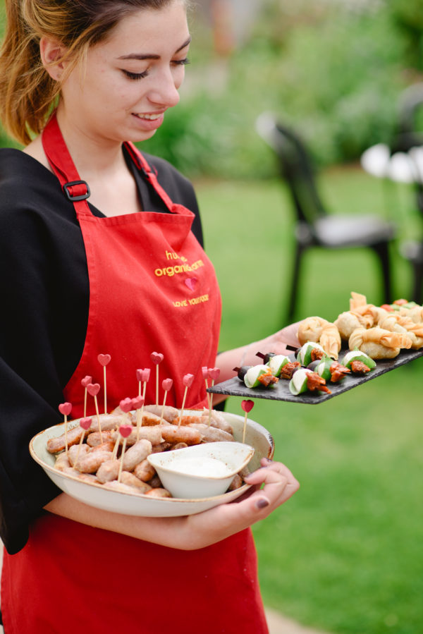 Catering staff carrying canapes